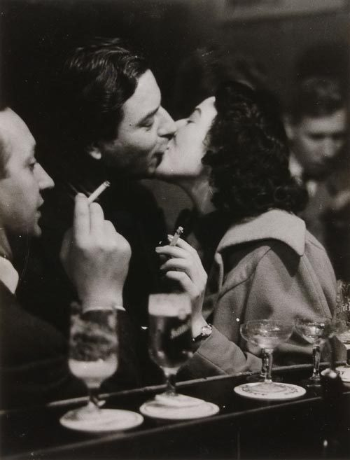 theniftyfifties:  A couple kissing at the bar, 1956.