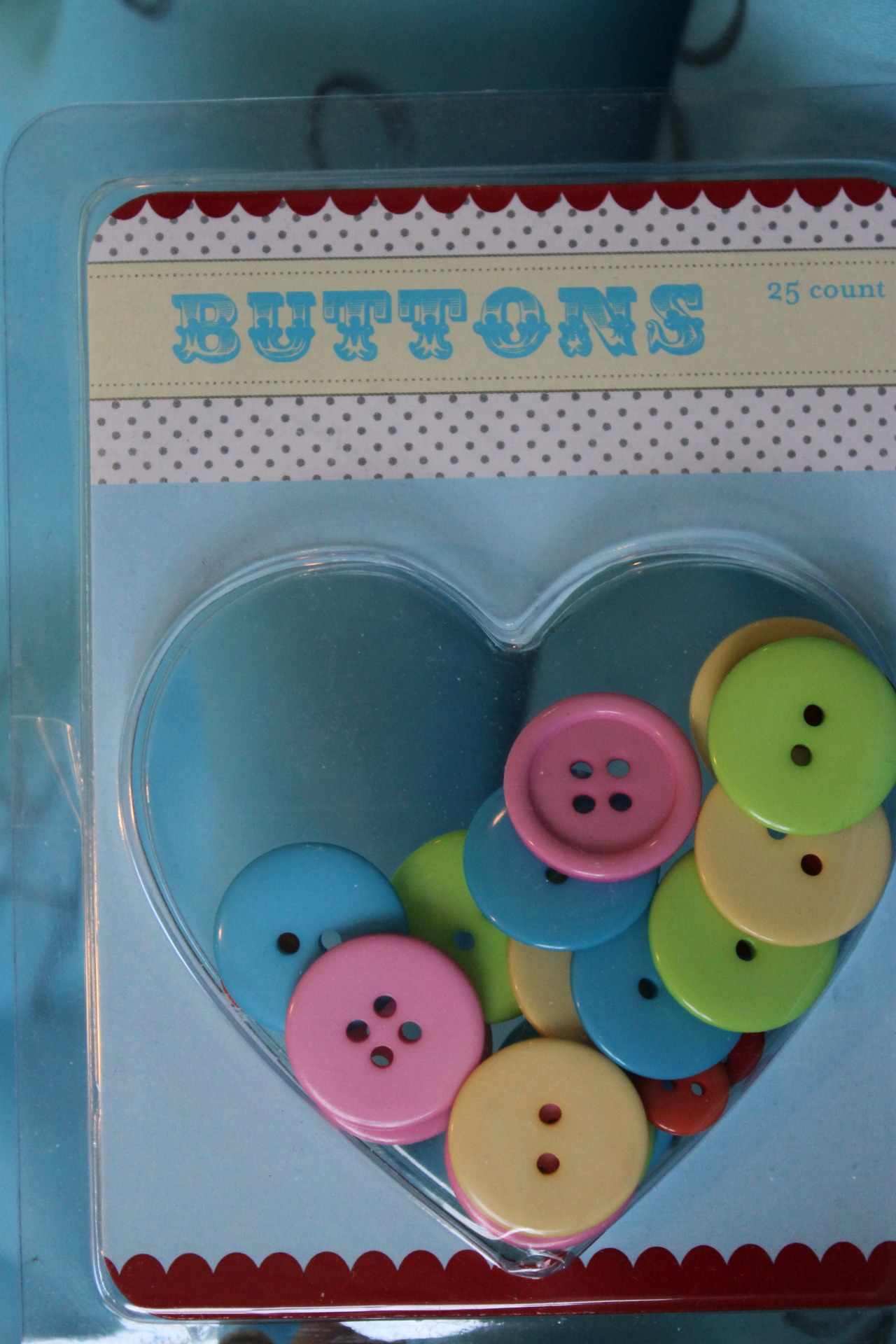 An adorable package of buttons that my equally adorable friend, Beasley, got me from the Target dollar section!