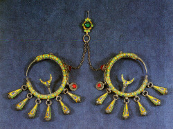 tzilah:  Earrings. Morocco, 1st half 20th century. Silver and enamel. Sometimes these earrings were fastened through the ear, sometimes next to the ear. The hook on top was fastened to the headscarf. Source: 'Ethnic Jewellery. From Africa, Asia and Pacific Islands.' René van der Star (ed.). Photographs: Michiel Elsevier Stokmans.