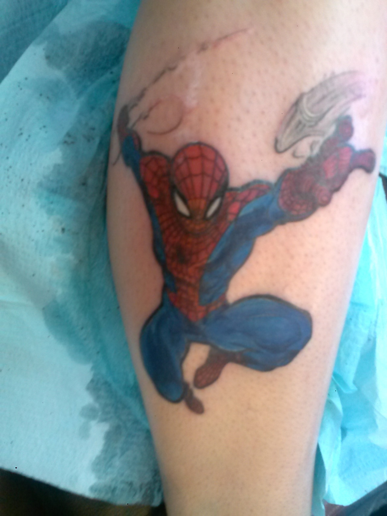 fuckyeahtattoos:  Spiderman swinging on my leg.  Done @ phat joes in miami, fl.