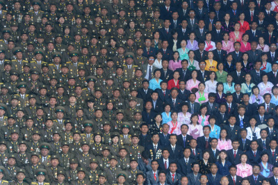 DPRK Army soldiers and civilians on the stand of the Kim Il Sung Stadium.