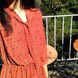 In the beautiful sun with grapefruit colored dress
