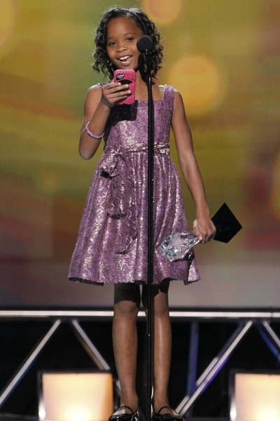 "Quvenzhané Wallis walked away with the Critic's Choices Award for best young actor/actress last night. With her smartphone in her hand, the 9-year-old actress stole the hearts of viewers as she accepted award last night. She told the crowd: ""First I would like to thank God for all my blessings.  I would also like to thank the film critic's for this award.' Thanks to Mr. Benh Zeitlin and the Court 13 family for thinking I could make a good Hushpuppy. Lastly, to my family, friends and fans—good night!"" [via The YBF]"