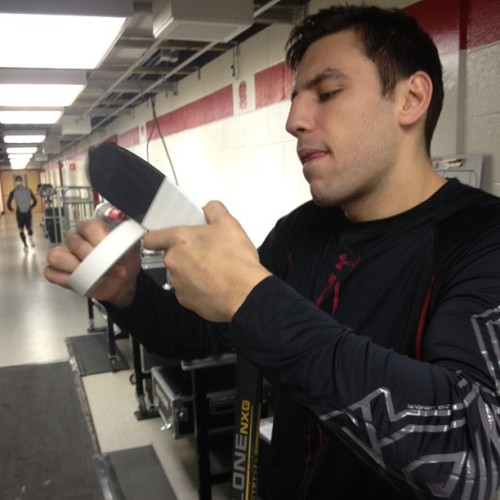 Milan Lucic tapes his stick prior to morning skate in Raleigh. #nhlbruins