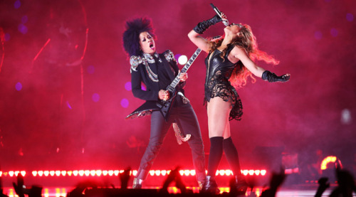 "gotagirlcrush:  Got a Girl Crush On: Beyoncé's all-female live band Musical director and guitar player BiBi McGill plays guitar next to Beyonce Knowles during the Pepsi Super Bowl XLVII Halftime Show on February 3, 2013 in New Orleans, Louisiana. (Photo by Christian Petersen/Getty Images)   But What About Beyoncé's Band? Whether you're a fan or not you have to admit Beyonce's Knowles performance at the Super Bowl was full of explosive energy. Her 13-minute performance included a 120 dancers, a 10-piece all female band and several back up singers. Then there's the Super Dome staff, stage, lighting and costume designers, the choreographer, the hair and make up folks, the list goes on. It's no surprise Beyoncé is getting all the attention but since no one else is talking about the musicians that made that performance happen it's a great opportunity to highlight the band. Beyoncé says she started the 10-piece all female band called ""The Sugar Mamas"" so young girls could have more role models. ""When I was younger I wish I had more females who played instruments to look up to. I played piano for like a second but then I stopped,"" Beyoncé said in a statement. ""I just wanted to do something which would inspire other young females to get involved in music so I put together an all-woman band."" Meet some of the band members that make up Beyonce's band ""The Sugars Mamas.""  (via softjunebreeze)  This is relevant to my interests."