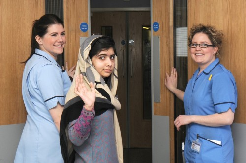 inothernews:  DEFIANCE  Pakistani schoolgirl Malala Yousafzai, center, with members of hospital staff, left Queen Elizabeth Hospital in Birmingham, England. The 15-year-old girl was shot by the Taliban in October for campaigning for girls' education. (Photo: AFP-Getty Images via The Wall Street Journal)  A big day for Malala Yousafzai, as well as the countless people around the world who've been moved by her spirit, and harrowing plight.