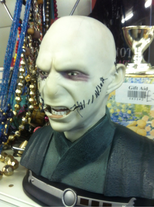 Found him in a Glasgow charity shop. Somebody had cut up poor voldy's face and then sewn in back together!