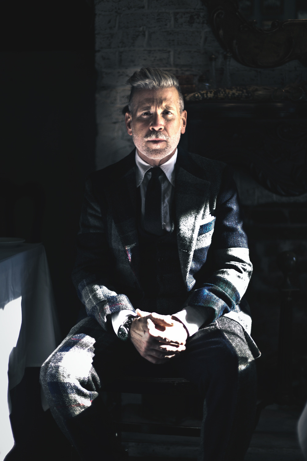 "The Creators of NYC: Menswear Icon Nick Wooster This story was coproduced in partnership with The Daily Beast. Josh Wool spent a decade as an executive chef, opening restaurants across the south. But all that changed in 2010, when the carpal tunnel in his hands meant he could no longer work. To keep from going stir crazy, he picked up a camera and found his next calling. Two years, thousands of portraits, and a move to New York later, Wool is documenting the people who inspire him on a daily basis. Welcome to Creators of NYC. Nickelson Wooster Nickelson Wooster is a veritable master of all things sartorial. He's been called the ""alpha male of American street style"" by GQ and has redefined the norm for modern masculine fashion through his work at Bergdorf Goodman, Neiman Marcus, Calvin Klein — and now JC Penney. His personal brand, a kind of of rugged style meets elegance, has shaped the way men dress all over the world. We caught up with the Kansas native at Bobo, one of his favorite West Village restaurants. Can you describe what inspires your style? Getting dressed for me is like a window to my soul. I grew up in the 60s and 70s when men were required to wear a suit, shirt, and tie every day to be taken seriously. I was at the tail end of that generation, and it had a significant impact on me. I always favor being overdressed –- if I'm not wearing a suit, I'm wearing a jacket. What does fashion say about a person? To me, how you dress is a way to show you care. I think the way you dress is a direct reflection out of what you will get out of your day; you make the effort, people will notice. You'll feel better, and those around you will feel better. Tell us about your new(ish) role at JC Penney. I want to offer customers a way to feel better about themselves. I have found that guys are not only interested in style — they really want to know how they can get it at a good price. If I can offer our customers an upgraded point of view at prices they are comfortable with, I think it is a win for everybody. But people don't exactly think of JC Penney in the same league as Niemen Marcus or Barneys. Is that your job, to remake the brand into something more chic? I'm not proposing three-armed jackets; I'm just proposing taste at an affordable price. Have you ever had a job you hated? Following college graduation, I moved to New York to work for Saatchi & Saatchi. The job itself was not crappy, it was just a really crappy fit because it was all numbers, tons of spreadsheets, and analyzing business — all before computers. Years later, I realize it gave me a good understanding of what drives business; but at the time, I did not want to do it. Now you're all over the computer. Do you think social media has changed the way we consume fashion? Absolutely. Tumblr, the Fancy, Instagram — it has democratized fashion in a new way, giving everyone instant access to what is happening on the runways and the street. I'm really interested to see how the publishing and retail worlds might blend together. What advice can you give the average guy on how to look sharp on a budget? Fit is so important … it's about details, not about spending a fortune. What's your favorite thing about living in New York? The great thing about New York is neighborhoods are so close to one another, yet have their own distinctive feel. The West Village has been my home off and on for 30 years, and I love how it retains the feel of local shops — my tailor, barber, and shoemaker are all within 100 feet of my front door. — Photos and interview by Josh Wool"