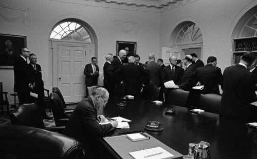 March 16, 1967. LBJ has a meeting with his National Advisory Council on Economic Opportunity. Attendees listed in the Diary include:  Mr. Morris Leibman, Chairman - Chicago Attorney Rev. George Davis - Washington, D. C. (Pastor National City Christian Church) Mr. Otto Eckstein - Harvard Professor (former member of CEA) Dr. Hector Garcia - Corpus Christi. Texas Mr. Jesse C. Kellam - Austin. Texas - KTBC-TV, Austin Dr. Walter Lane - Temple Terrace, Florida Hon. Theodore McKeldin - Mayor of Baltimore  Mrs. Robert McNamara Mr. Albert Rains - Attorney, Gadsden, Alabama Mr. David Sullivan - Pres. , Building Service Employees Int'l Union Mr. Cato Valandra, President of the Rosebud Sioux Tribe, Rosebud, So. Dakota Hon. Louis Welsh - Mayor of Houston . Mr. Whitney Young - Executive Director National Urban League Hon. Horace Busby - 1225 19th St. , N. W. , Wash, DC Rev. John P. Cody - Archbishop of Chicago Sargent Shriver Hon. Chas. Schultze - Director, BOB Harry McPherson LBJ Library photos: A3834-2a, before the meeting begins: A3834-30, Mrs. Robert McNamara (L) and Whitney Young (R) in conversation. Harry McPherson (behind Young) and another Council member look on; Whitney Young (at right) in conversation with an unidentified Council member. All public domain.