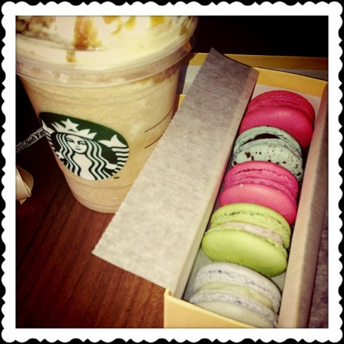 Frappucino and French Macarons while doing homework and studying. Everything's great except for the imminent doom of finals! #coffee #starbucks #frenchmacaron #macarons