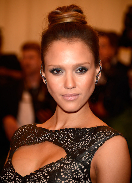 Jessica Alba Punk Style Snake Earrings, Smokey eyes, & Neutral Lips. at the Red Carpet of Costume Institute Gala for the 'PUNK: Chaos to Couture' exhibition at the Metropolitan Museum of Art 2013. May 7th, 2013 7:50 P.M. GMT.