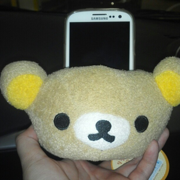 The sweet new phone holder @jemuelb got for himself. :3 #rilakkuma #parkingvalidationsucks
