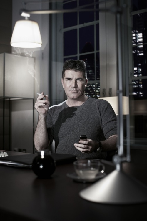 ianderry:  When you photograph Mr @SimonCowell you know there are 2 things never far from him . His phone and his cigarettes #simoncowell #photography