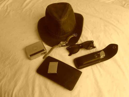 My summer hiking carry….wayfarers, very tough old leather wallet, Gizeh roll box and Zippo, Catamaran sports watch and my trustee Buck 110. I never go hiking without a good, solid knife.