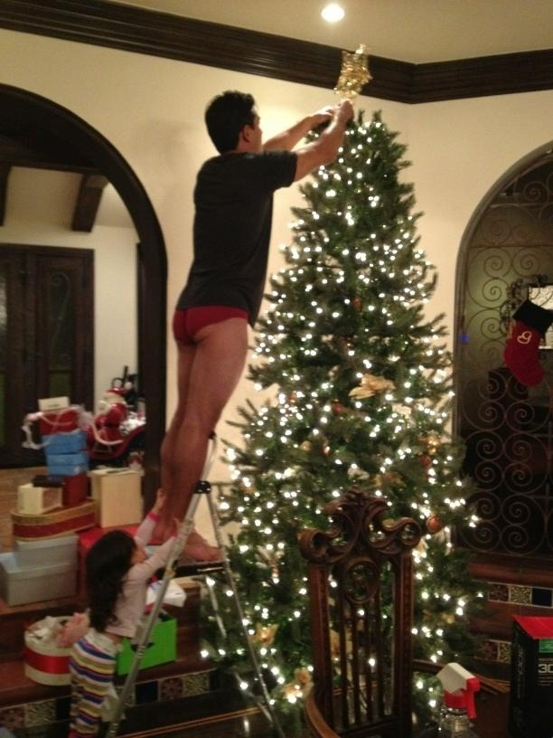 How Mario Lopez trims his Christmas tree. [Insert joke about jingle balls here]