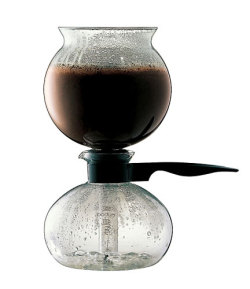 Your coffee fix of the day: Near boiling water is forced into a glass chamber with coffee grounds. The mixture steeps until the heat is turned off. As it cools, the water is sucked back into the lower chamber.