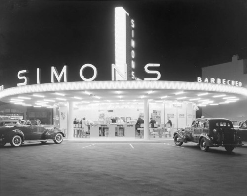losangelespast:  A clean, well-lighted place: the welcoming neon glow of Simon's Drive-In Cafe at night, Wilshire and Fairfax, 1939.