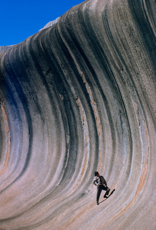 wnycradiolab:  natgeofound:  A wave of rock shaped by wind and rain towers above a plain in Western Australia, September 1963. Photograph by Robert B. Goodman, National Geographic  Damn.