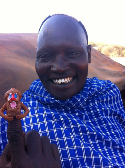 This picture of Maasai chief, smiling and laughing while wearing one of our finger puppets, made everyone at Archie McPhee very happy. It is awesome and inspiring and has made our year. [Picture taken by Peter Richards]