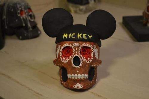 "Yes, Disney Is Actually Attempting to Trademark ""Dia de los Muertos""  From the article at Phoenix New Times:  In 10 applications filed May 1 through the U.S. Patent and Trademark Office, Disney Enterprises Inc. is attempting to trademark the phrase ""Dia de los Muertos."" If successful, the corporation would be able to go after individual companies who attempt to use ""Dia de los Muertos"" for profit in the areas of education and entertainment, goods and services, apparel, toys, and food items.   Aside from the obvious outrage that an American corporation would attempt to do this, I have to wonder if we are going to be inflicted with a ""Princesa Muerta"" as well.  UPDATE: Well, that was a quick backpedal. Yalí Noriega tells me on Twitter that last night, amidst the rightful anger that this trademark application generated, Disney withdrew the request."