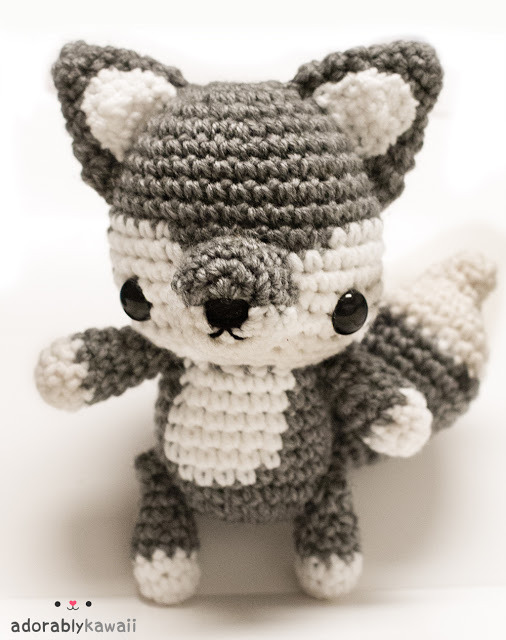 "I made this for MalonB in the Amigurumi Swap. It's about  8"" tall standing and about 5"" at the widest. The tail is about 4.5"" long and 2.5"" wide. I couldn't decide on how I wanted to position the legs so I made them jointed! Now it can sit or stand! :D    I made another wolf because I don't make jointed amigurumi often enough!! It's fun. I made the arms, legs, and tail jointed. Mr. Baby already claimed it by spitting up all over it though.  I remember getting requests from deviantART users to make a wolf version of the Sleepy Fox and I'll still do that. I may make it soon while I still have some gray yarn left."