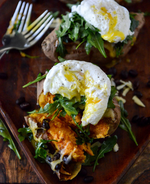 gastrogirl:  cheesy black bean stuffed sweet potatoes with arugula and poached eggs.