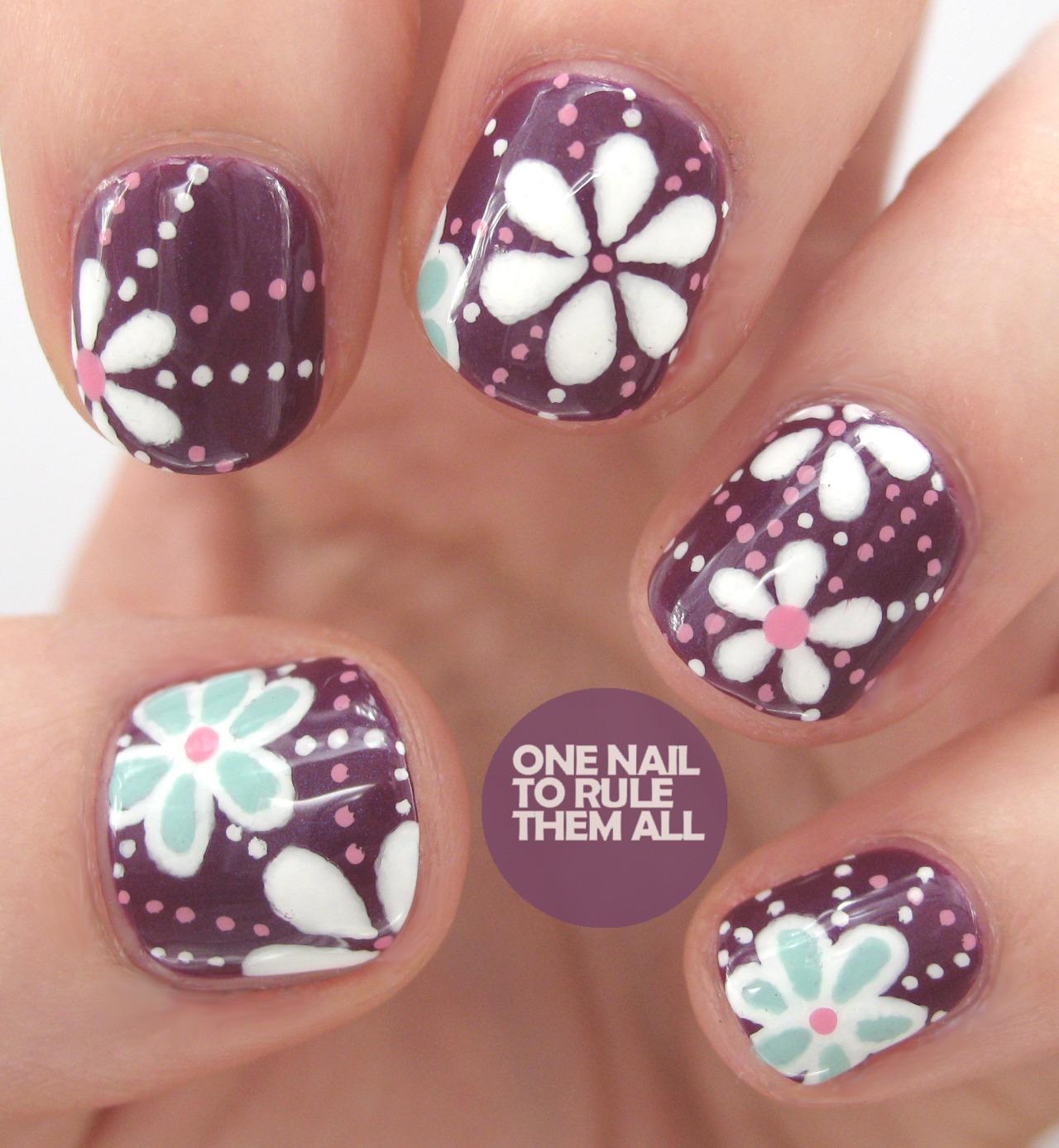 onenailtorulethemall:  Then and Now: Week 16. You can see what these looked like over 2 years ago (my first pictured design ever!) and also see my right hand for the first time ever, on my blog