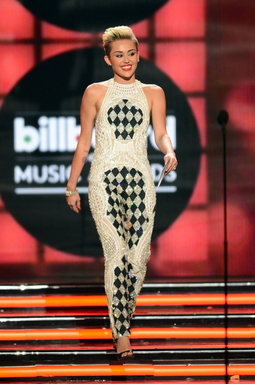 Miley Cyrus speaks onstage during the 2013 Billboard Music Awards at the MGM Grand Garden Arena on May 19, 2013 in Las Vegas, Nevada.