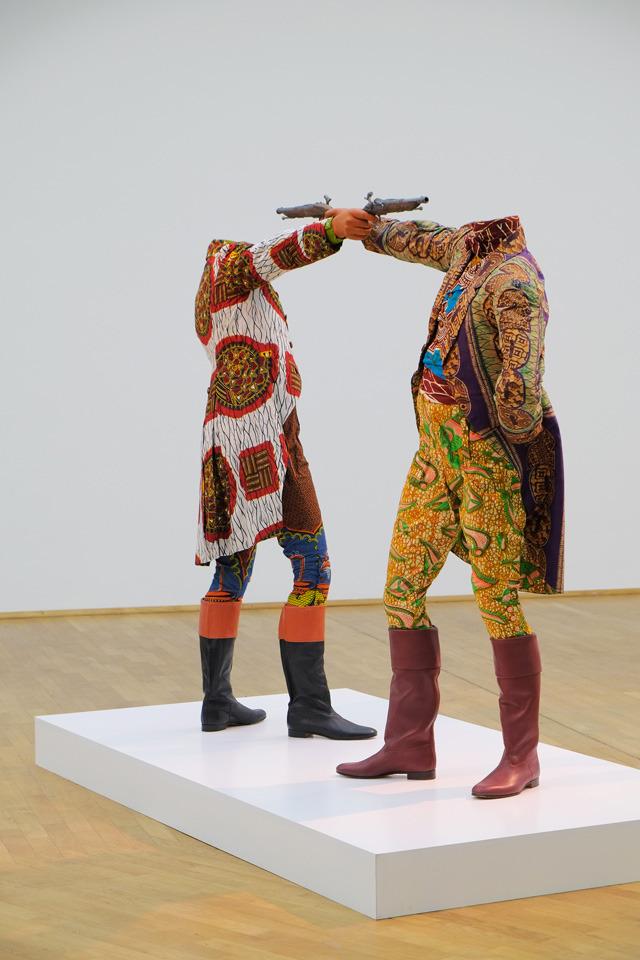 blackcontemporaryart:  Yinka Shonibare, MBEHow To Blow Up Two Heads At Once (Gentlemen) – image Axel Schneider © MMK Frankfurt