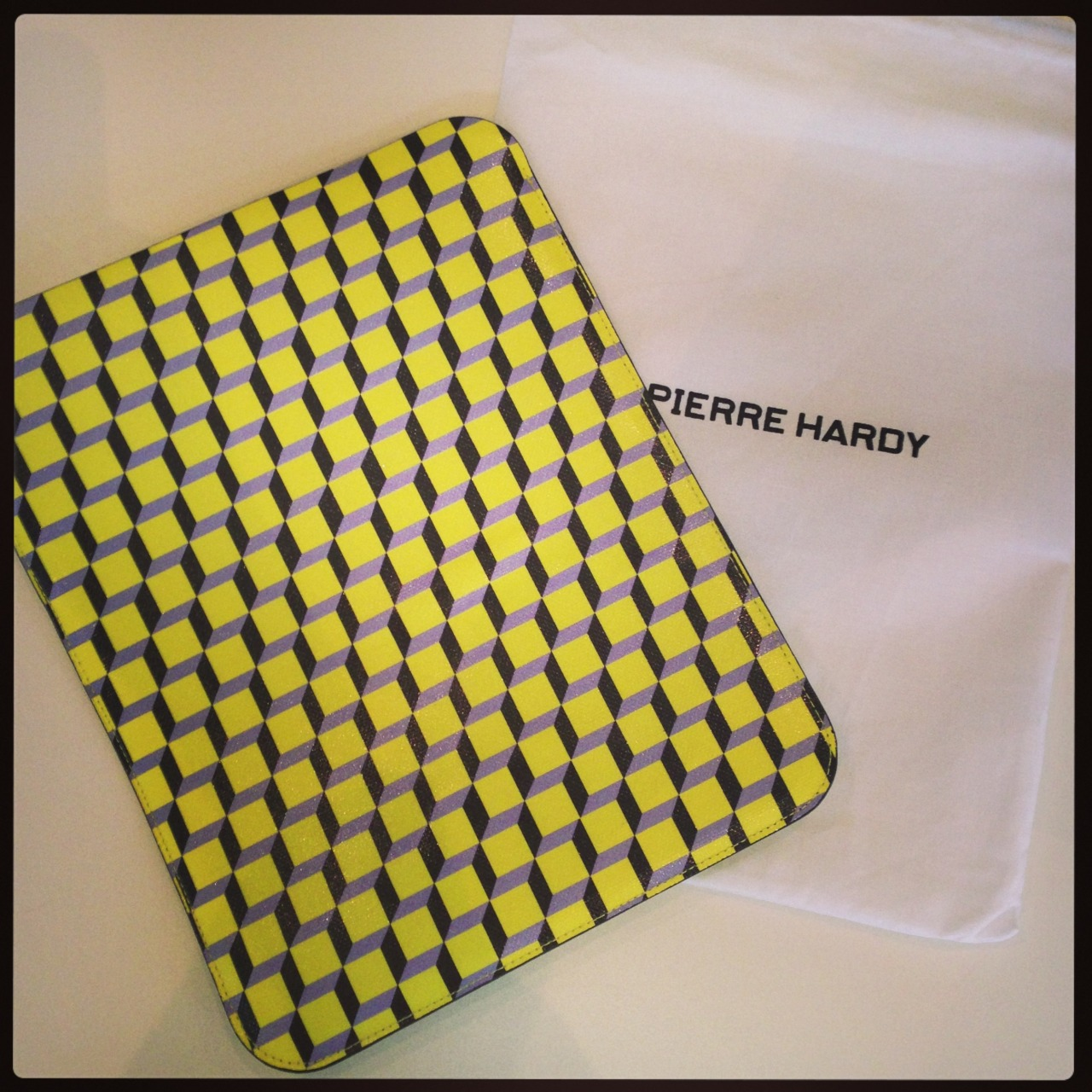 "Australia Trip Essentials | This iPad case from Pierre Hardy, with a print that screams ""I will not let you forget me on this plane.""   Shop > http://mr-p.co/PuF8ED"
