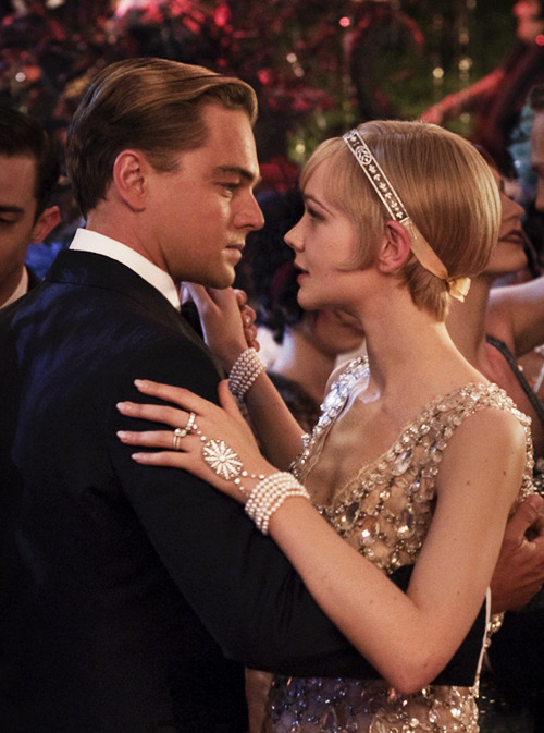 Leonardo DiCaprio as Jay Gatsby and Carey Mulligan as Daisy Buchanan in The Great Gatsby (2013).