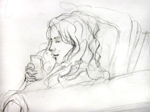 Texting HB pencil on a piece of scrap paper A sketch of my sister from life while she was texting messages on her phone.