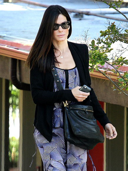 We just love Sandra Bullock with dark hair! It looks FAB against her perfect ivory skin! To boot, her square cat-eyes make her look oh-so-edgy!