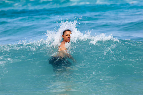 The president swims at Pyramid Rock Beach in Kaneohe Bay on Jan. 1. More White-House photos here.  Official White House photo by Pete Souza