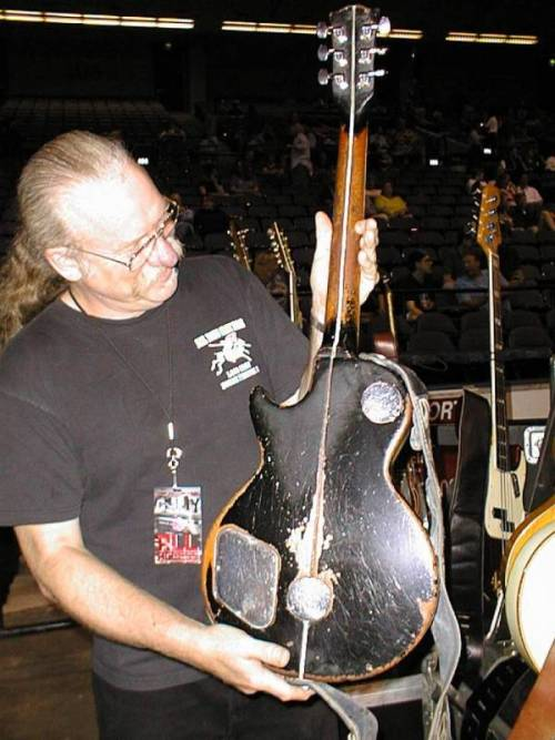 Larry Cragg, Neil's guitar technician for many years, shows the Old Black's back . (via Old Black)