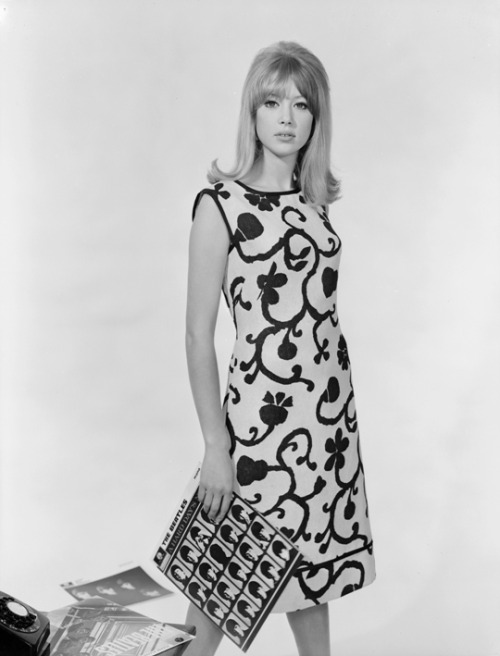 ladiesofthe60s:  Pattie Boyd posing with A Hard Day's Night and other Beatles records.