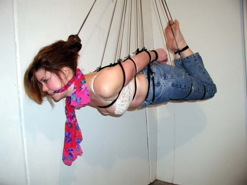 graybandanna:Flying hogtie, love the dangling end of the scarf gag