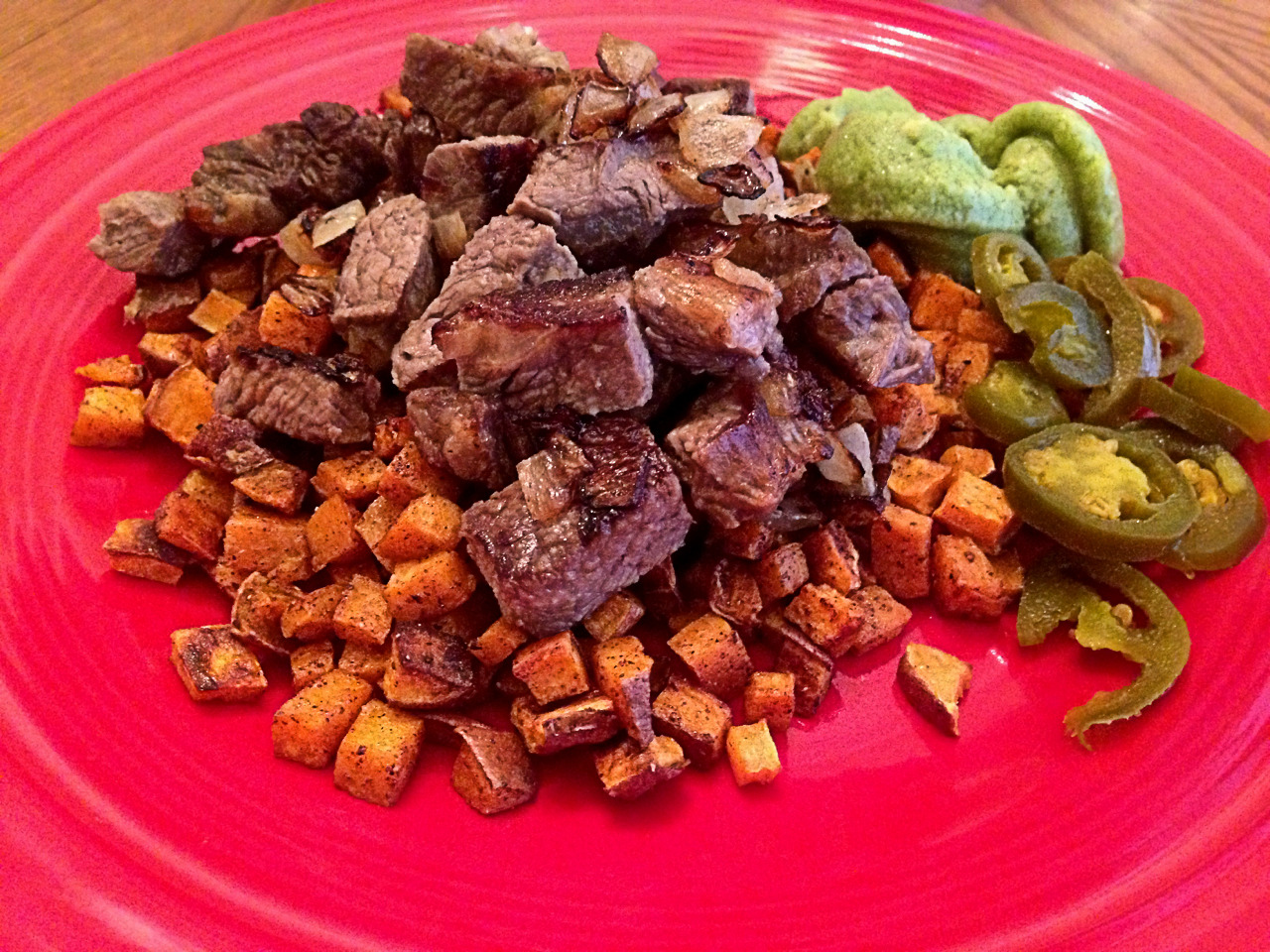 Breakfast: steak strips, sweet potato fries, guac, and jalapeno peppers (All WLC compliant, by the way). The best part about this was the prep time took next to nothing.  Sure, it took some time to cook the sweet potatoes but we have done exceptionally well at meal planning and prepping this week. I cooked the majority of the meat on Sunday.  Last night I cut up the sweet potatoes and got the pan ready to cook.  This morning most of the hard work had already been done, so it took a lot less time. Over the weekend I had written out a meal plan and went shopping based on that.  When you have a 6 year old, a 3 year old, a job, etc. life gets hectic.  This planning and prepping might seem over the top, but this week we have done a great job at it and I am amazed at how much stress this relieves. Last night when I got home and my wife was at the gym, I didn't have to stare into the fridge and wonder what to cook.  I just looked at our meal plan and did it.  I knew we had the ingredients, some of which had already been prepared.  That peace of mind has been helpful for us but most importantly, allowed us to stay focused and not deviate from eating clean.
