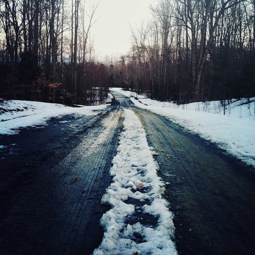snowy gravel road.