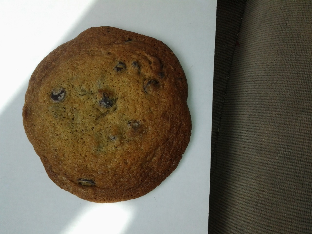 chocolatechipcookiela:  Location: Whole Foods Fairfax and Santa Monica Rating: 5 This cookie is perfectly adequate. Sometimes it taste a little like a fridge but overall it's semi chewy and okay, neither super thin or super thick or super cakey. Occasionally Whole Foods will try to only have vegan cookies which are less than adequate although I guess they're good for vegan chocolate chip cookies so if you're into that they're a win. If you're in the neighborhood and want a cookie this one's okay.  There will be way better cookies in the future and way crappier cookies in the future…this is the average. Red Alert: The Whole Foods on Fairfax and Third often does not have a regular stock of cookies so keep that in mind.  Just started an LA chocolate chip cookie rating tumblr