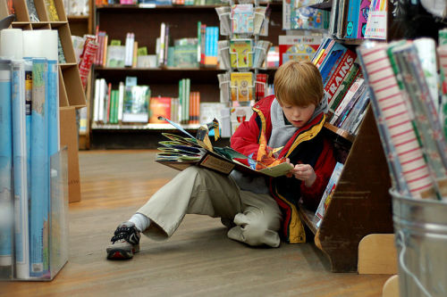 Child reading at Brookline Booksmith - X