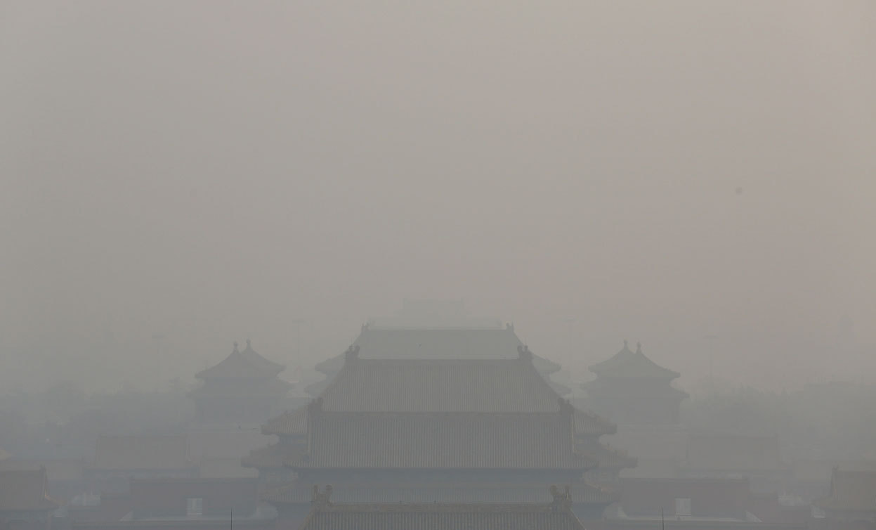 From China's Toxic Sky, one of 31 photos. The rooftops of Beijing's Forbidden City, obscured by thick smog, in Beijing, China, on January 16, 2013. (Feng Li/Getty Images)