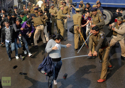 anarcho-queer:  Protesters Clash With Police In India's Capital Over Brutal Group Rape Indian police fired tear gas, batons and water cannons against protesters in the capital New Delhi as thousands demanded the death penalty for five men who raped a 23-year-old student. Some of the demonstrators sustained injuries. Crowds of protesters attempted to make their way to the presidential mansion at Raisina Hill and then tried to break through steel barricades surrounding a high-security zone where the presidential mansion, the prime minister's office and various ministries are located. The protesters carried banners that read 'Save women, save India' and 'Hang the rapists.' Police cracked down on the rally after some demonstrators began to throw stones at security forces. The clashes come after days of protests sparked by a brutal attack on a young student. Protesters are demanding the death penalty for the five suspects, who were detained following the December 16 attack. The sixth assailant apprehended on Friday. The group of drunk men attacked the woman and her 28-year-old friend while on a charter bus that drove through the city for hours, even passing through police checkpoints. The assailants were armed with iron rods, and gang-raped the victim and brutally beat her and her friend. They were both then dumped on the side of the road on at high speed. Doctors at the hospital where the victim was taken said she remains in critical but stable condition, and has been removed from her ventilator. The violence prompted activists to demand that the government tougher measures to protect women from the daily threat of harassment and violence. General Vijay Kumar Singh, a retired Indian army chief, called for the training and arming of security forces to deal with the issue. On Friday, Indian officials announced a broad campaign aimed at protecting the rights of women in New Delhi. The government also said it would demand life sentences for the woman's six attackers and pay the victims medical bills, and promised stricter policing to prevent future such incidents. Hundreds of students and activists blockaded roads in New Delhi on Friday and marched to the president's palace, breaking through police barricades.  New Delhi, with a population of nearly 17 million people, has the highest number of reported sex crimes of all India's cities. The number of reported rape cases in the capital has risen 17 percent from 2011, to 661 this year, government figures revealed. According to police statistics, a rape is reported on average every 18 hours, and a sexual assault occurs every 14 hours in the capital.