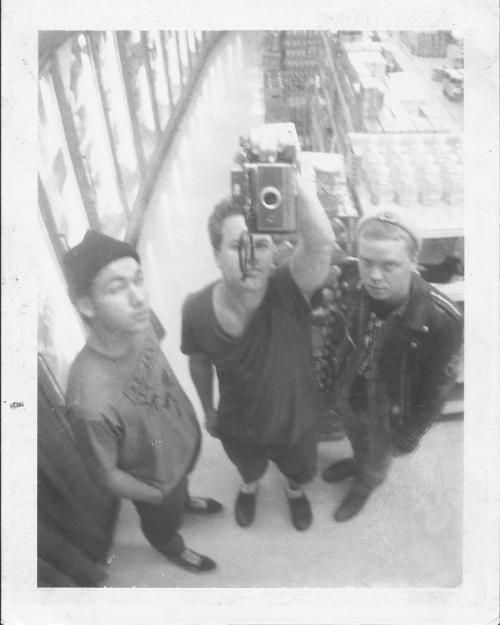 therookielot:   Jawbreaker taking a group-selfie using a Polaroid 100 Land Camera in a 7-11 mirror in 1989.  F