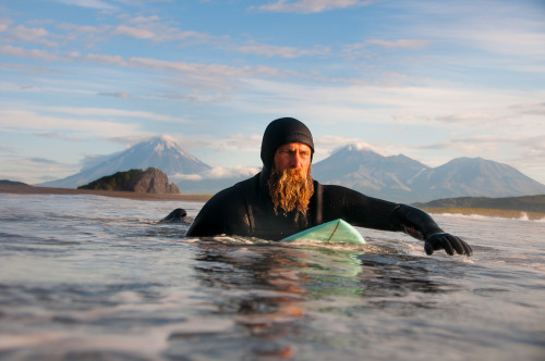 chrisburkard:  Keith Malloy paddling out into the Kamchatka lineup…