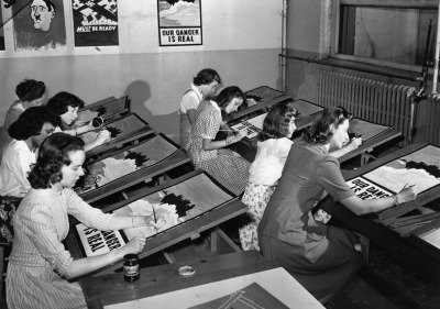thequantumbear:  historicporn:  Woman making WWII propaganda.New York, 1942.   holy shit are they hand-painting posters? the WPA was pretty rad, huh