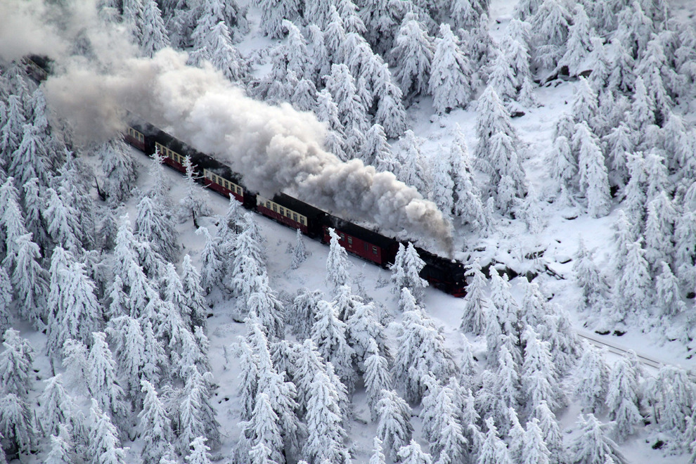 aubade:  A train of the Brocken Railway steams through a winter landscape with snow covered pine trees as it approaches its destination on the Brocken mountain in the Harz mountainous region of Germany on Dec 8. (Stefan Rampfel/European Pressphoto Agency)