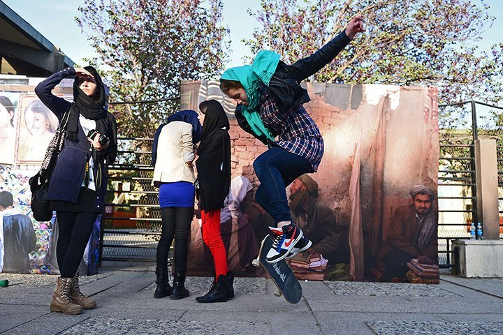 3 May 2013. Kabul. Afghanistan. A girl pops an Ollie as Afghan youths gather for the Sound Central Festival in Kabul. (Photo: Massoud Hossaini / AFP-Getty via The Guardian)
