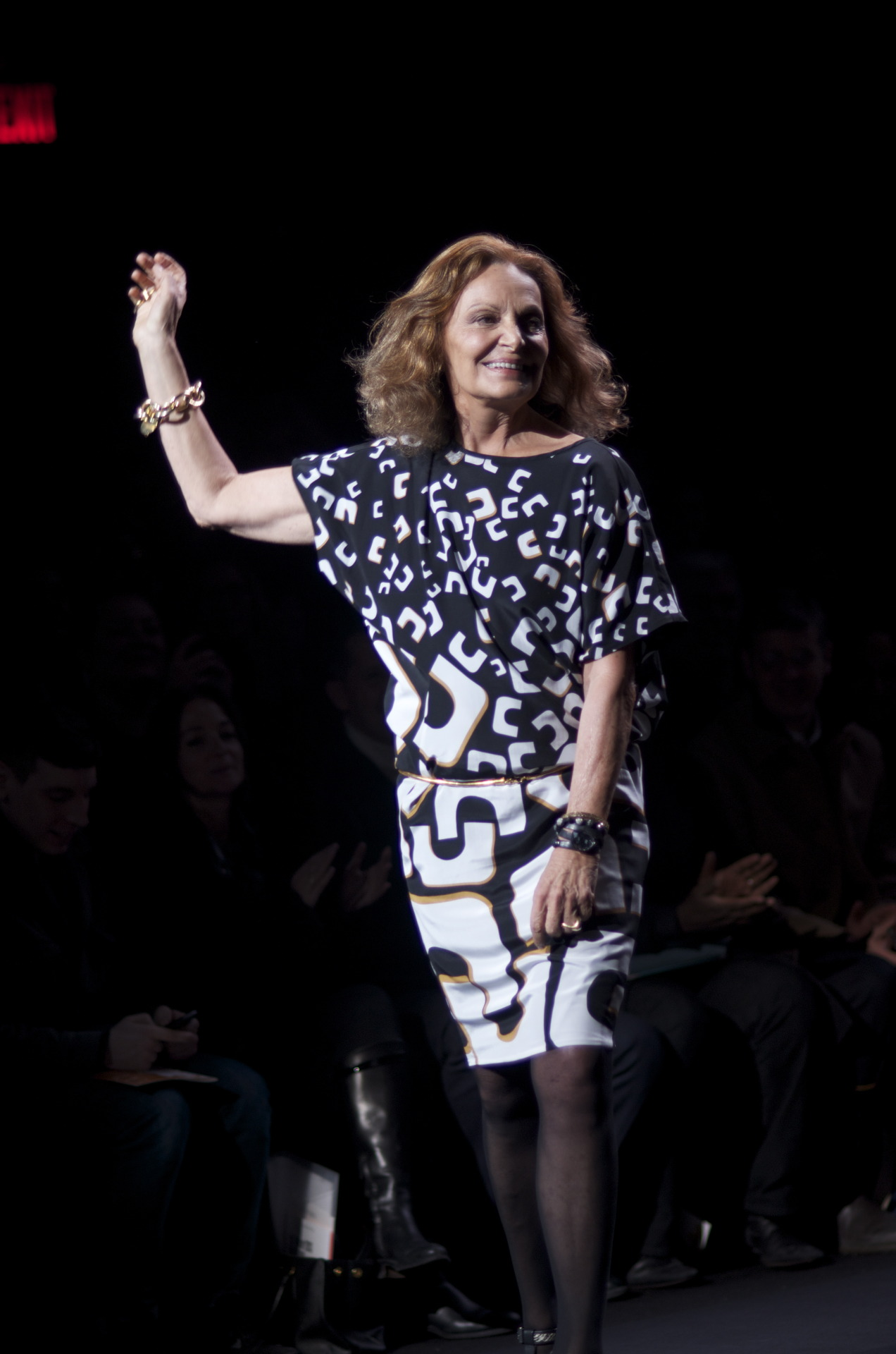 Diane von Furstenberg taking her always, much deserved final walk after the Fall/Winter 2013 show. Lauren Kristin for Fashionisto Diaries.