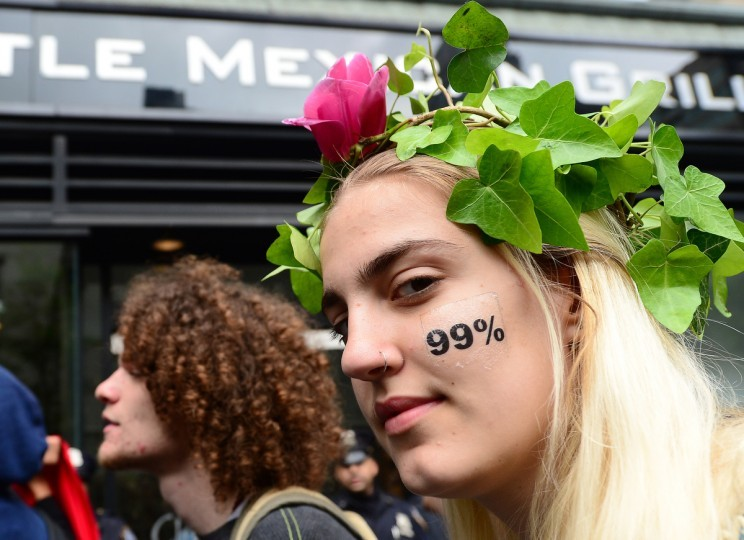 Occupy Wall Street participants stage a march part of May Day celebrations in New York. The Occupy movement that shook the United States last year, spawning similar protests worldwide, announced widespread May Day demonstrations and strikes against social inequality Tuesday. The protests, billed as stretching from New York to California, and from Spain to Australia, raised the possibility of disruption in dozens of urban centers on the date when many countries observe International Workers' Day. (Emmanuel Dunand/AFP/GettyImages)